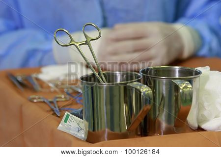 Surgical Clamp In Steel Jar