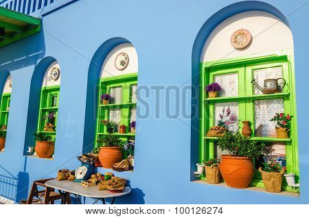 Colorful Greek restaurant with typical blue wall