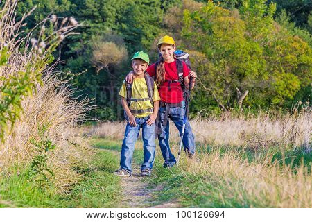 Two traveling kids with backpacks