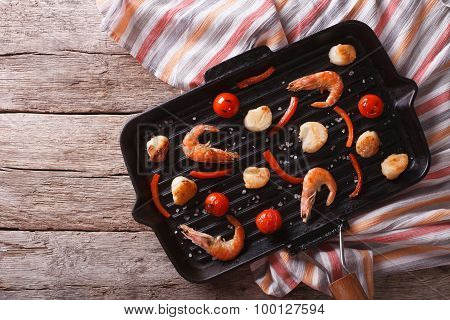 Grilled Shrimp And Scallops On The Grill Pan. Horizontal Top View
