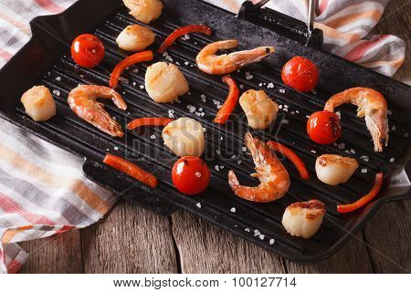 Shrimp And Scallops On The Grill Pan On The Table. Horizontal