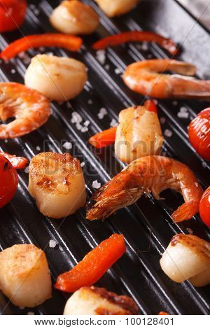 Scallops And Shrimp Are Fried On The Grill Close Up. Vertical
