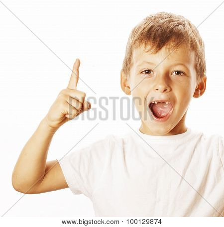 little cute white boy pointing in studio isolated close up