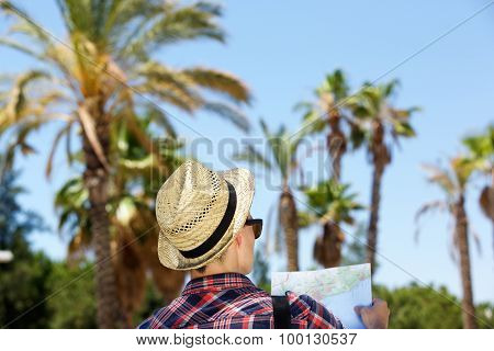 Male Traveler Standing Outside With Map