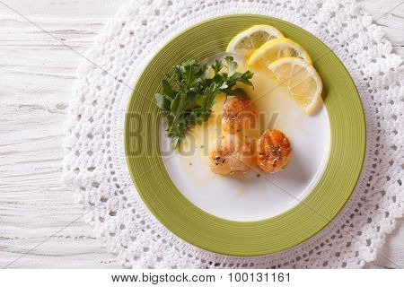 Fried Scallops With Sauce And Lemon. Horizontal Top View