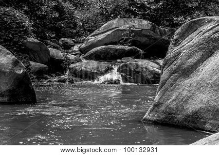 River Stream Flowing Over Rock Formations In The Mountains