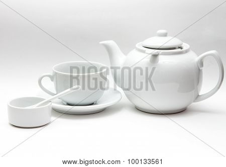 white tableware, large kettle, Cup, bowl, porcelain spoon on a gray gradient background