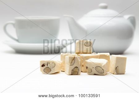 Oriental sweets with nuts on the background of the tea kettle