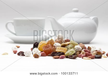 mixed nuts and dried fruit in the background the kettle and cups