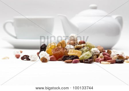 nuts and dried fruits, on a background of coffee makers, cups white closeup