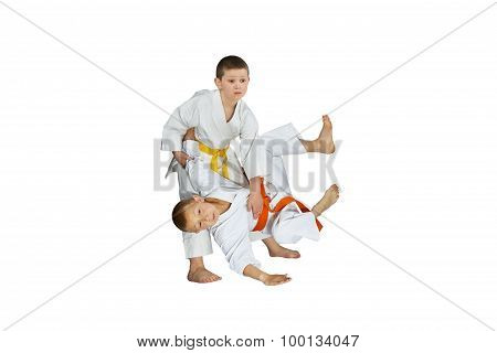 The athletes in judogi perform throws judo