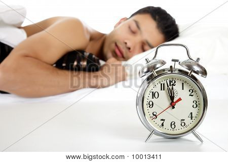 Young Nepalese Man And Retro Alarm Clock