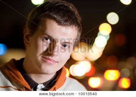 Portrait Of Teenager Boy At Night