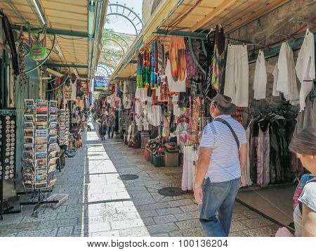 JERUSALEM ISRAEL - JULY 13 2015: Narrow stone street among stalls with traditional souvenirs