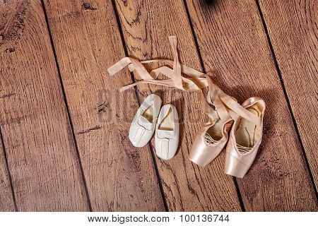 Gym Shoes And Ballet Pointe Shoes.