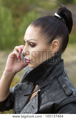 Profile of pensive pretty brunette young serious woman