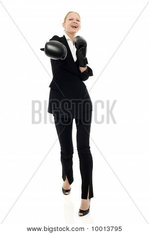 portrait of a young caucasian businesswoman smiling with boxing gloves