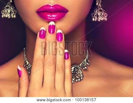 Crimson manicure and make-up , lip color fuchsia .