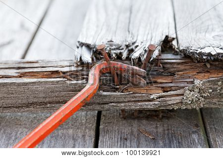 Claw Hammer And Rusty Nails On The Old Boards