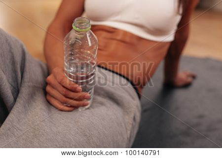 Woman Holding Water Bottle At Gym