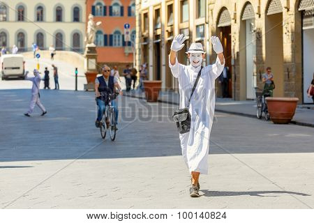 White clown on the street in Florence, Italy