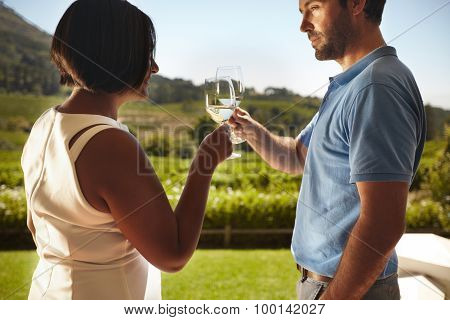 Young Couple Toasting Wine At Winery