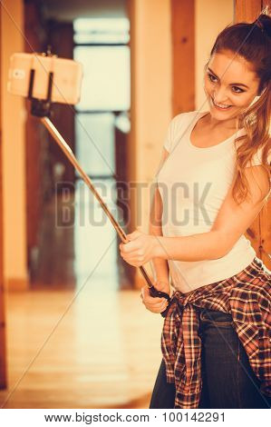 Happy Cute Girl Taking Photo With Selfie Stick.