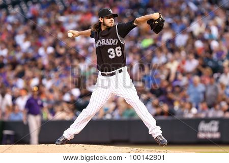DENVER-AUG 21: Colorado Rockies pitcher Christian Bergman pitches during a game against the New York Mets at Coors Field on August 21, 2015 in Denver, Colorado.