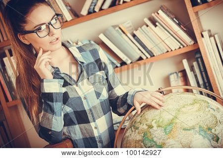 Hipster Girl In Library Working With Globe