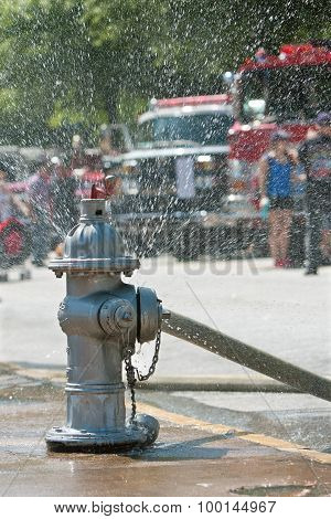 Fire Hydrant Sprays Water On Atlanta City Sidewalk