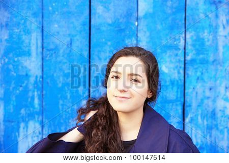 Beautiful Young Woman On Background Of Blue Wall