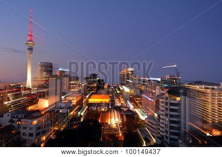 Motion Blur Background Of Auckland Financial Center Skyline At Dusk