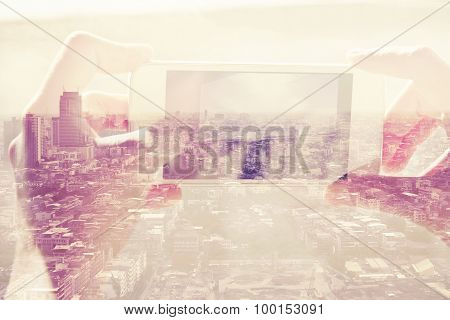 Double exposure of people with smart phone and cityscape