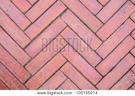 Walkway flooring from red brick block pattern.