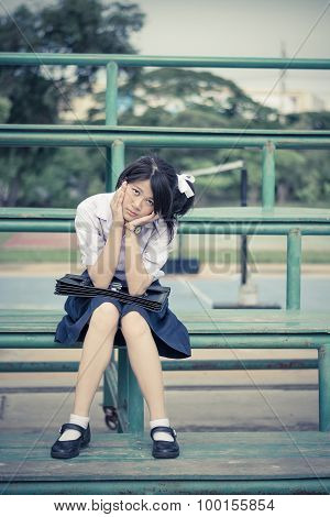 Asian Thai Schoolgirl Student In High School Uniform Education Fashion Is Sitting On A Metal Stand A