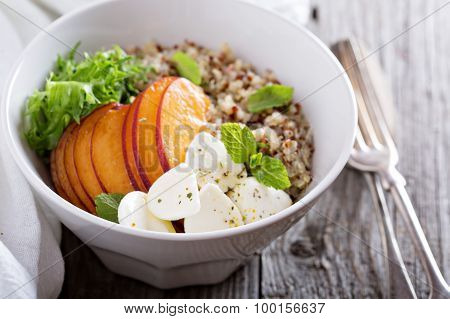 Quinoa bowl with peach and mozarella