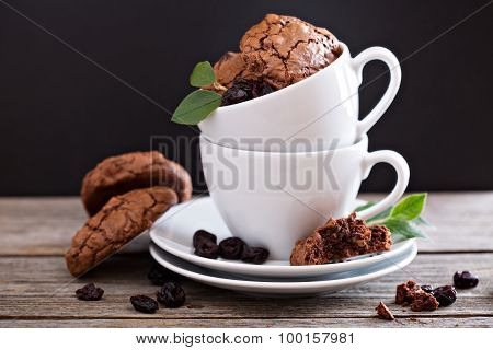 Chocolate cookies stacked in coffee cups