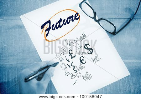 The word future and left hand writing on white page on working desk against currency symbols