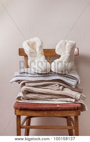 Sheepskin Slippers, Stack Of Warm Clothes
