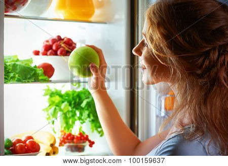 Night Hunger. Woman In The Dark At Open Refrigerator