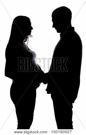 Silhouette pregnant woman and man holding hands