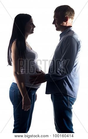 Image pregnant woman and man in shadows