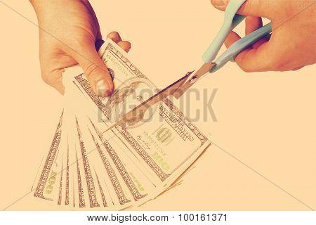 Male hands cut money