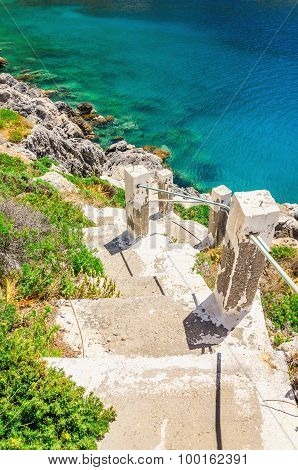 Stairs to the beach with green bushes, Greece