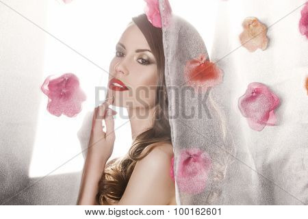 Beauty fashion model girl portrait with flowers. Beautiful luxury makeup and hair