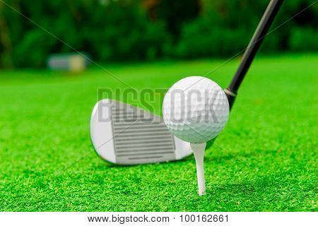Horizontal Shot The Putter And Golf Ball On A Lawn