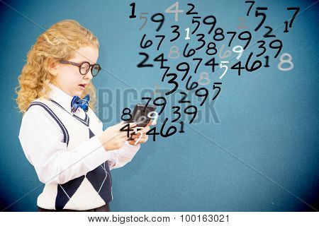 Cute pupil with calculator against blue background