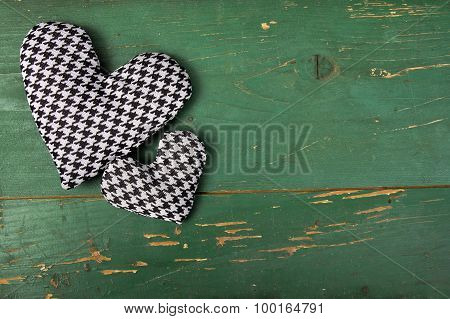 houndstooth hearts on a green background