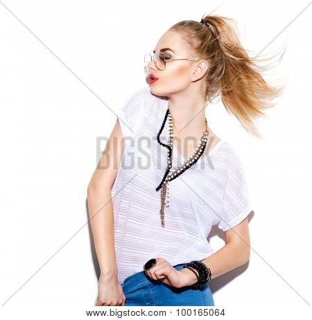 Fashion Model girl isolated over white background. Beauty stylish blonde woman posing in fashionable clothes and sunglasses. Casual style with beauty accessories. High fashion, urban style