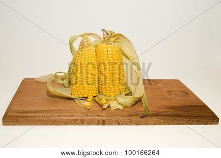 Several Ears Of Corn On A Wooden Surface